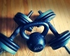 Kettle Bell and Dumbbells resting the floor