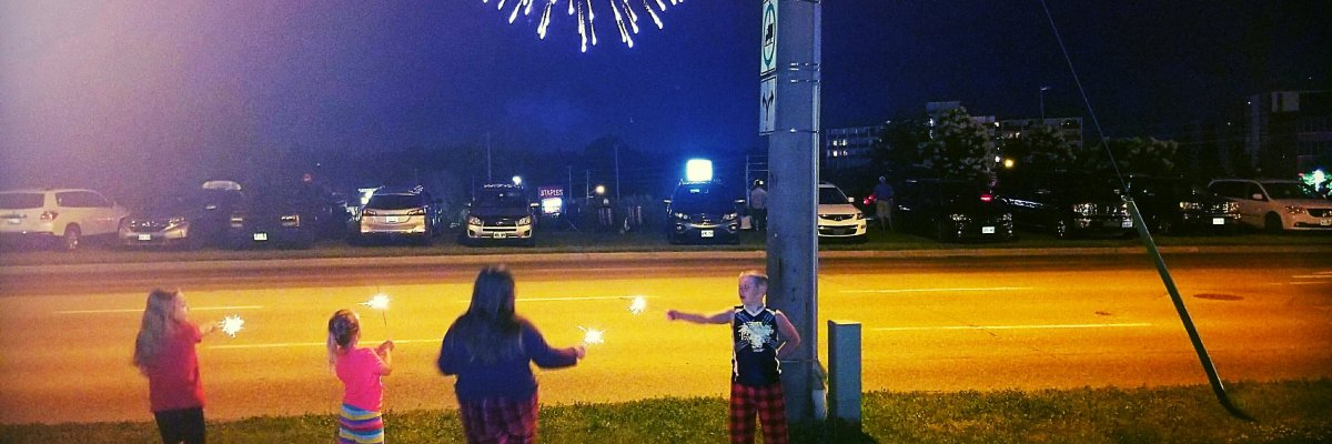 Kids, fireworks, street lights, sparklers