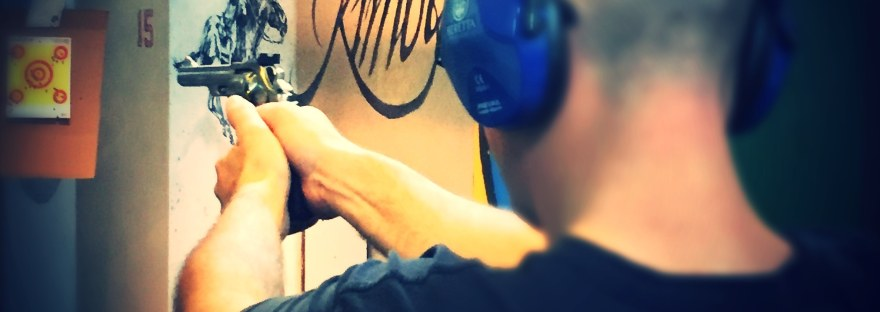 man shooting a magnum at a shooting range, blog header photo