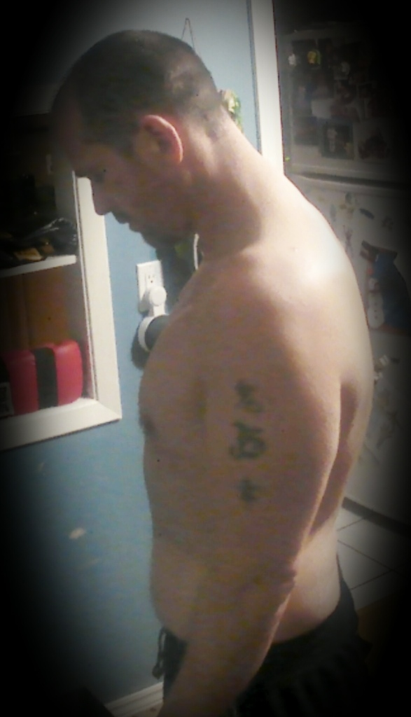 Weight loss picture of a man before a workout.  Side view.
