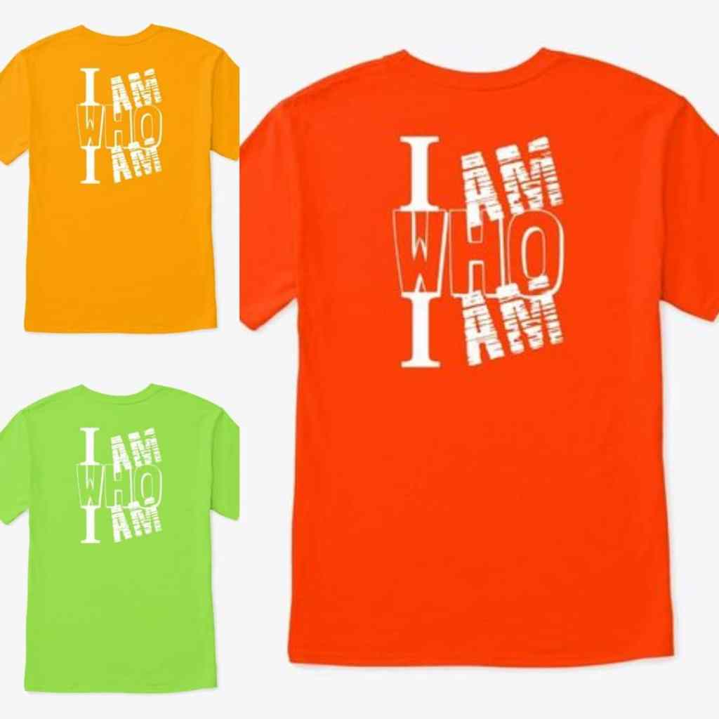 "Orange, Yellow and Green T-shirt with white writing. ""I am who I am"""